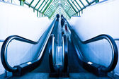 View to gray escalator in new trade cent — Stock Photo