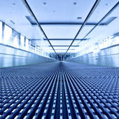 Escalator view in blue corridor — Stock Photo