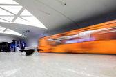 Orange train on platform — Stock Photo