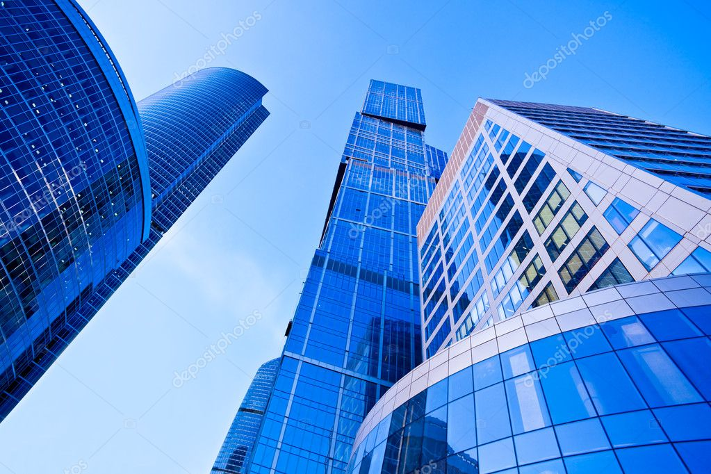 Modern blue skyscrapers towers in business centre perspective view — Stock Photo #1286812