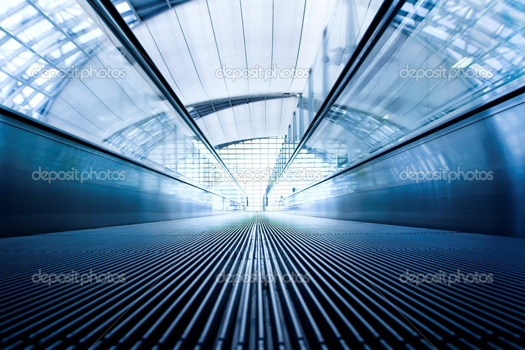 Moving grey escalator in office hall — Stock Photo #1287063
