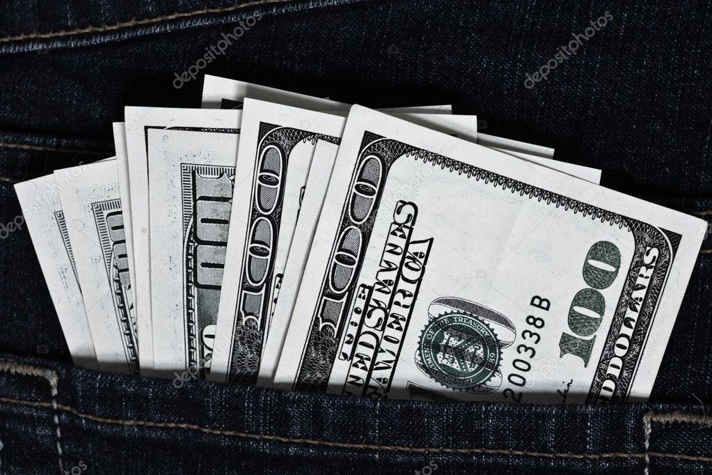 Dark jeans pocket with many one hundred dollars banknotes  — Stock Photo #1287077
