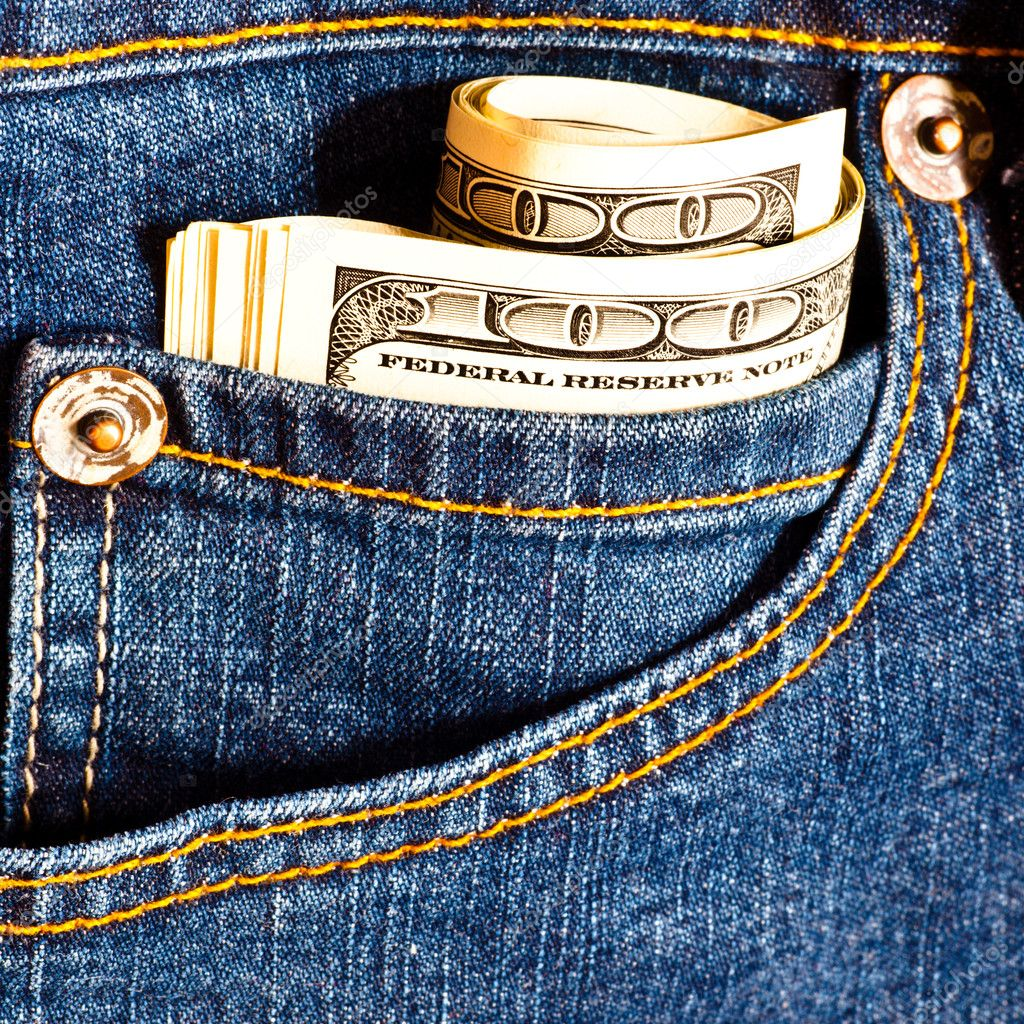 Jeans pocket with many one hundred dollar banknotes in roll — Stock Photo #1287140
