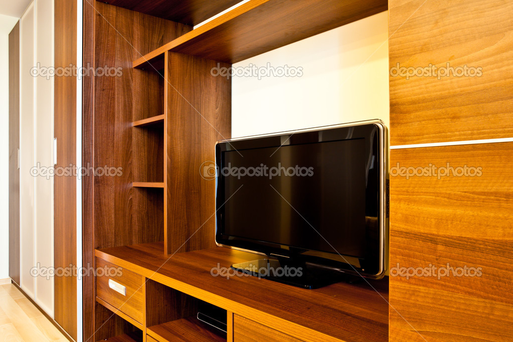 Comfortable room with TV and wardrobes  Stock Photo #1287948