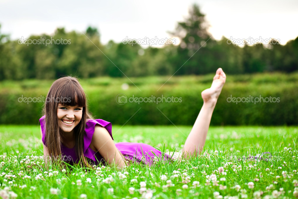 Lying pretty smiling girl with long brown hairs  — Stock Photo #1288595