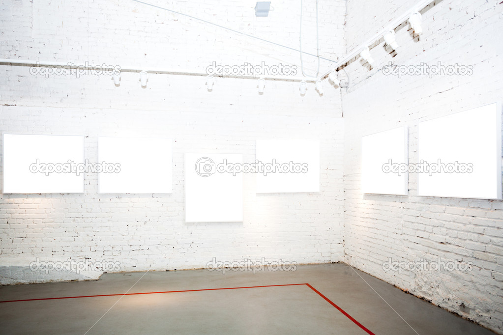 Brick white walls in museum with empty frames  Stock Photo #1288626