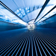 Moving travelator in office hall - Stock Photo
