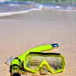 Yellow snorling mask on sand — Stock Photo #1319114