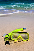 Yellow snorling mask on sand — Stock Photo