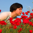 Girl on the poppies field — Stock Photo
