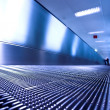 Blue moving escalator in the office hall — Stock Photo #1327926