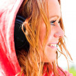 Smiling girl in headphones — 图库照片