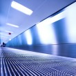 Blue moving escalator in the office hall — Stock Photo #1328072