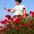 Girl on the poppies field — Stock Photo #1328147