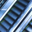 Three mooving escalators — Stock Photo
