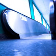 Royalty-Free Stock Photo: Blue moving escalator in the office hall