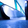 Blue moving escalator in the office hall — Stock Photo #1328230