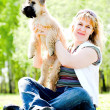 Terrier dog and woman - Stock Photo