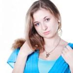 Smiling beautiful girl in blue dress — Stock Photo