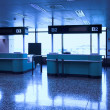Desks in airport - Stock Photo