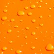 Water drops on orange metal background — Stock Photo #1328371
