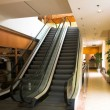 Two escalators in shopping mall - Stock Photo