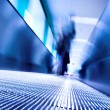 Blue moving escalator in the office hall — Stock Photo #1328438