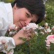 Woman smells roses — Stock Photo