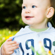Baby boy play with dandelions — Stock Photo #1329447