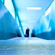 Blue moving escalator in the office hall — Stock Photo #1329505