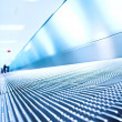 Stock Photo: Blue moving escalator in the office hall