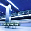 Blue fast train at platform - Stockfoto