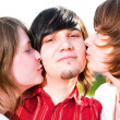Girls kiss young guy — Stock Photo