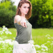 Beautiful girl pointing at you — Stock Photo
