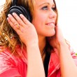 Smiling girl in headphones — Stock Photo