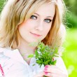 Beautiful girl portrait with flowers — Stock Photo