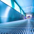 Blue moving escalator in the office hall — Stock Photo #1329980