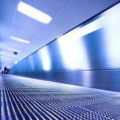 Blue moving escalator in the office hall — Stock Photo