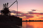 Crane on riverside — Stock Photo
