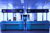 Desks in airport — Stock Photo