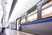 Blue fast train stay at platform — Stock Photo