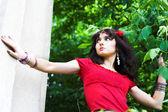 Girl in red near church — Stock Photo