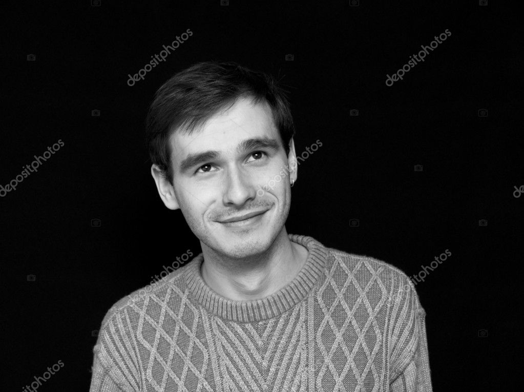 Smiling man in sweater watching up BW — Stock Photo #1327839