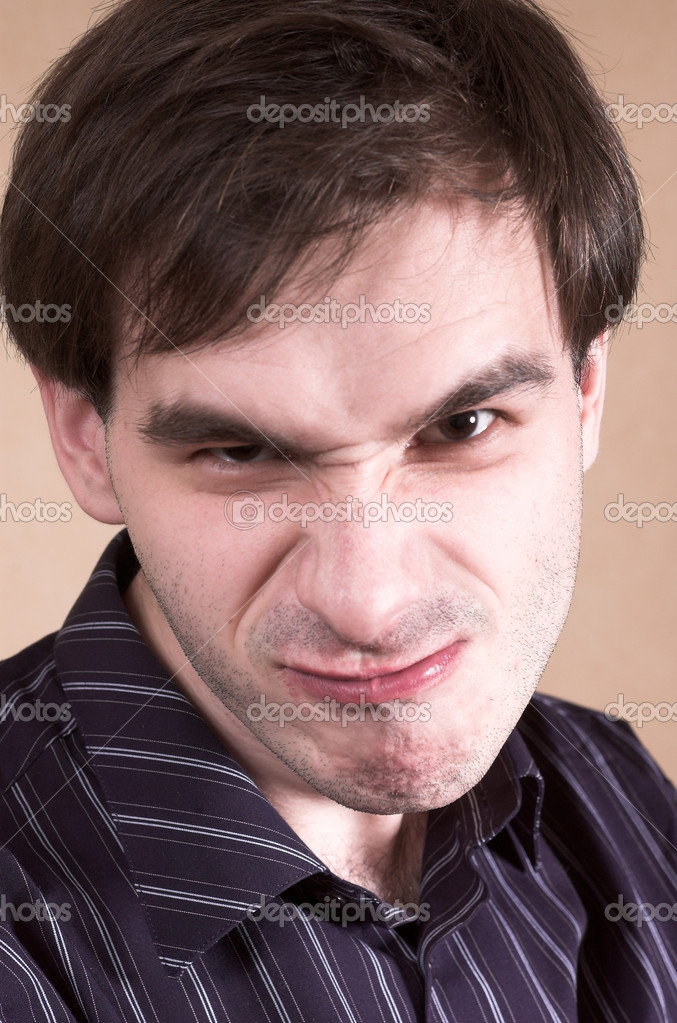 Evil man with strange smile  Stock Photo #1328014