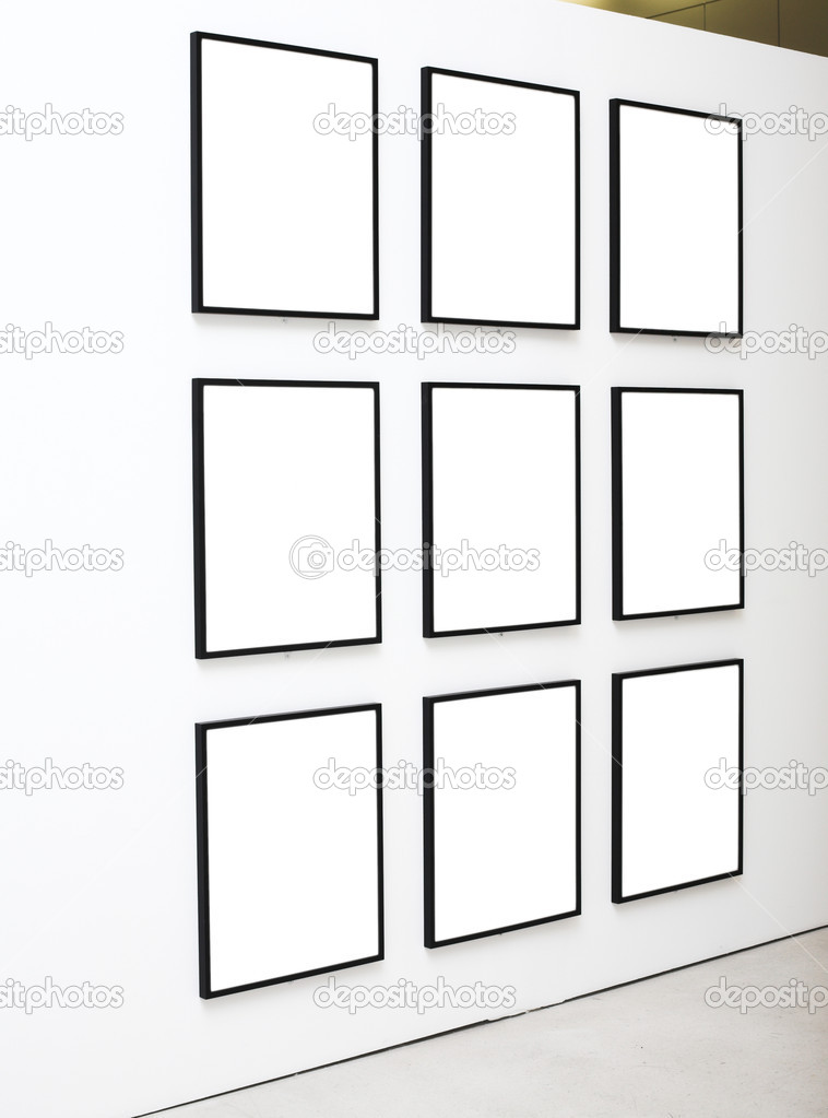 Nine empty frames on white wall exhibition in Museum — Stock Photo #1328733