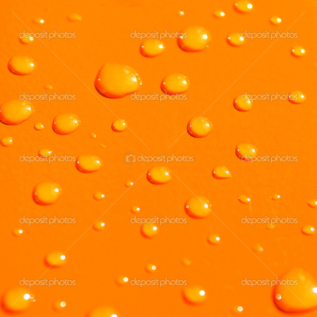 Water drops on orange metal macro background — Stock Photo #1328890