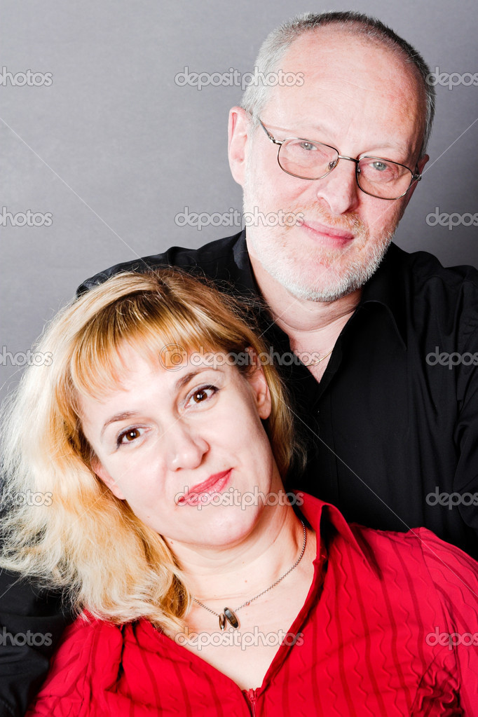 Smiling adult couple in studio — Stock Photo #1328911