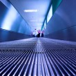 Blue moving escalator in the office hall — Stock Photo #1330014