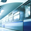 Royalty-Free Stock Photo: Blue fast train stay at platform