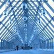 Blue glass corridor in bridge - Stockfoto